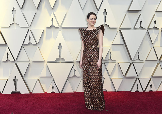 Emma Stone arrives at the Oscars on Sunday, Feb. 24, 2019, at the Dolby Theatre in Los Angeles.
