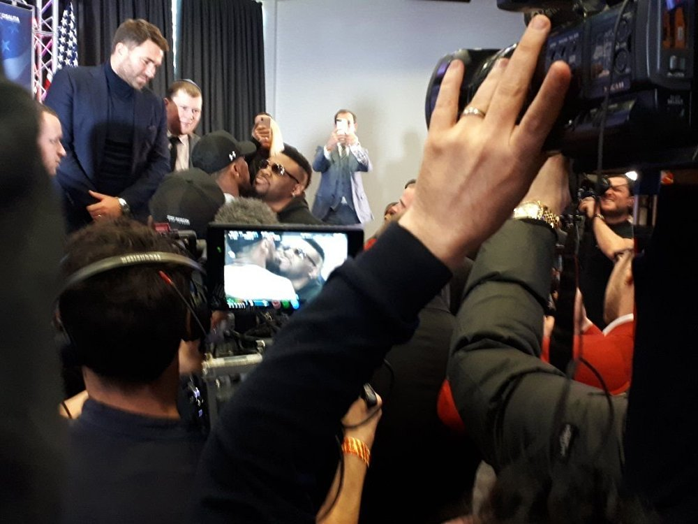 Promoter Eddie Hearn looks on (left) as Anthony Joshua and Jarrell Miller square up at a press conference in London on 25 February 2019