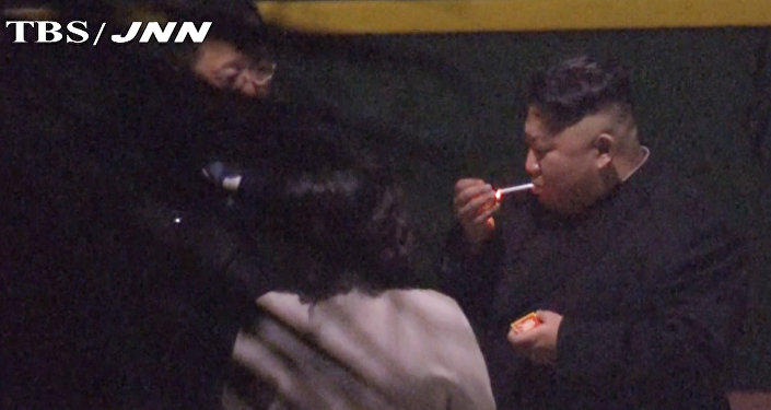 In this image made from Japan's TBS TV video on early Tuesday, Feb. 26, 2019, North Korean leader Kim Jong Un, a habitual smoker, takes a pre-dawn smoke break at the train station in Nanning, China, hours before his arrival in Vietnam for his high-stakes summit with President Donald Trump over resolving the international standoff over the North's nuclear weapons and missiles