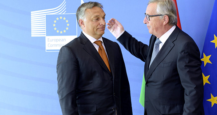 Hungary's Prime Minister Viktor Orban (L) is greeted by European Union Commission President Jean-Claude Juncker of Luxembourg prior to their meeting at the European Union Commission headquarter in Brussels. File photo