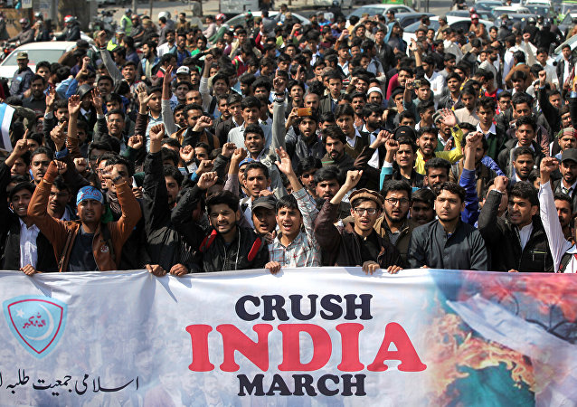 Supporters of Jamiat Talaba Islam (JTI), student wing of religious and political party Jamaat-e-Islami (JI), chant slogans as they celebrate, after Pakistan shot down two Indian military aircrafts, in Lahore, Pakistan February 27, 2019
