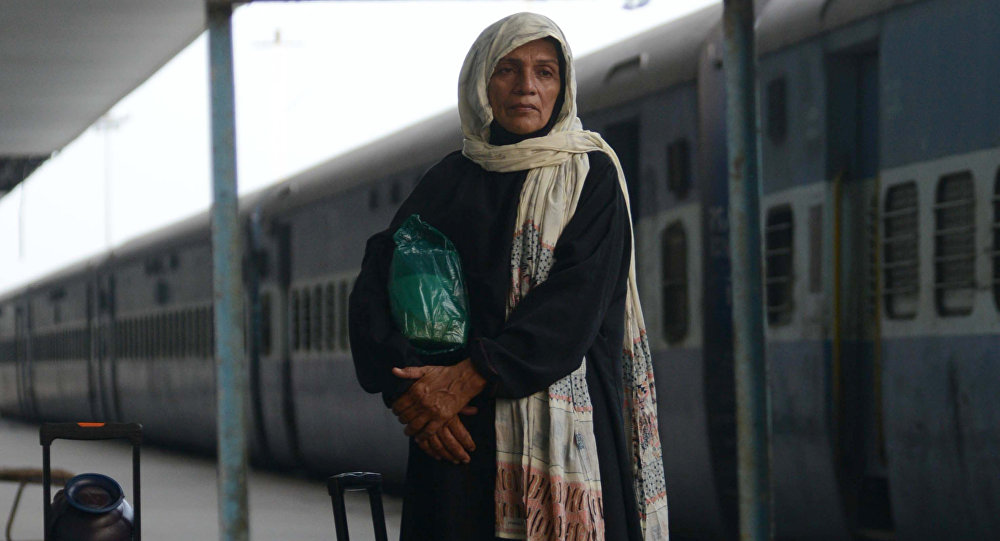 Pakistani passengers from the Samjhauta Express arrive from Pakistan at Attari Railway Station, about 35 kms from Amritsar on September 29, 2016