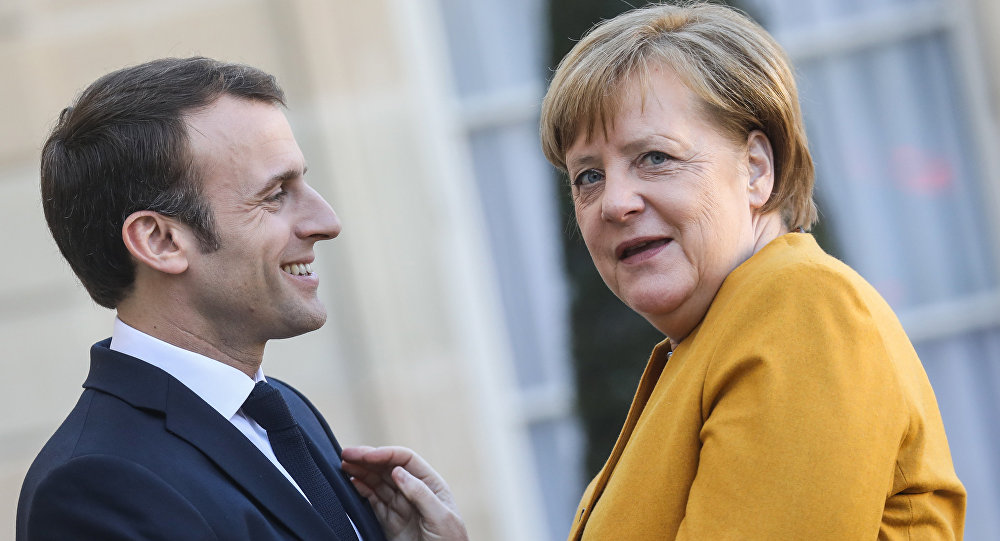 French President Emmanuel Macron (L) welcomes German Chancellor Angela Merkel as she arrives for a working meeting at the Elysee Palace on febuary 27, 2019, in Paris