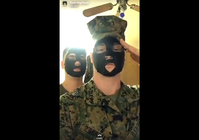US Marines investigated after video surfaces, showing the pair posing in blackface