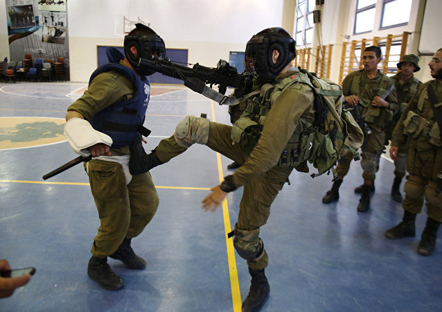 Israeli Golani infantry soldiers take part in a training of Krav Maga, the close-combat method conceived in secrecy by the Israeli military, in the Regavim Army base, in northern Israel on April 19, 2016