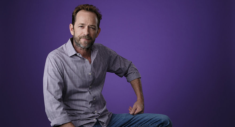 Luke Perry, a cast member in the CW series Riverdale, poses for a portrait during the 2018 Television Critics Association Summer Press Tour, Monday, Aug. 6, 2018, in Beverly Hills, Calif
