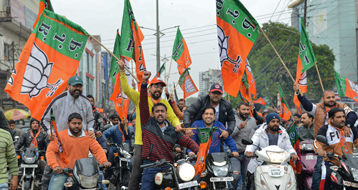 Indian Bharatiya Janata Party (BJP) workers hold BJP flags during a 'Vijay Sankalp' bike rally in Amritsar on March 2, 2019