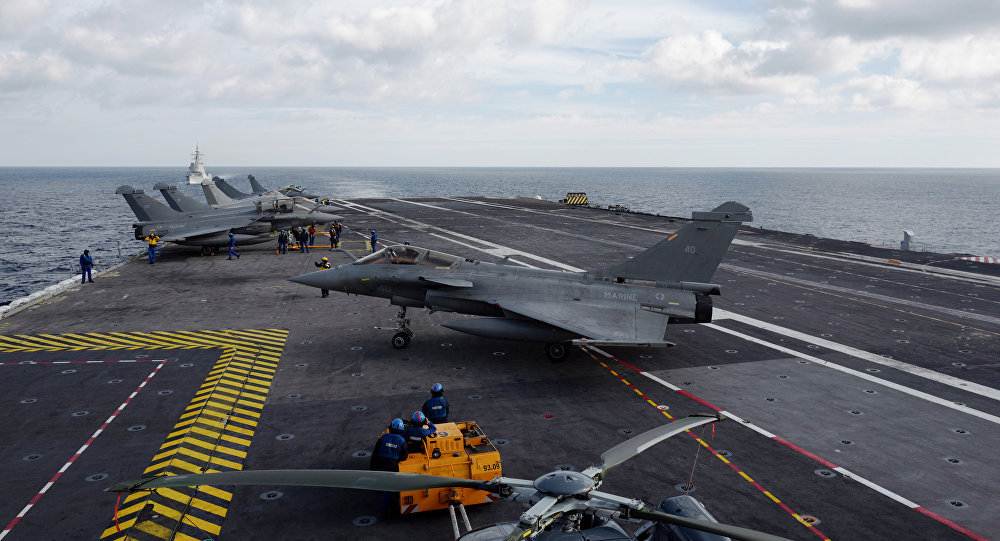 A French Rafale fighter taxis after landing on the deck of the Charles de Gaulle aircraft carrier on February 7, 2019 in the Mediterranean sea