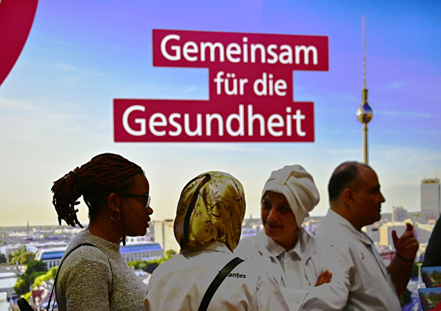 Visitors and exhibitors attend a job fair for migrants launched by the German job center (Bundesagentur für Arbeit) in Berlin on January 28, 2019