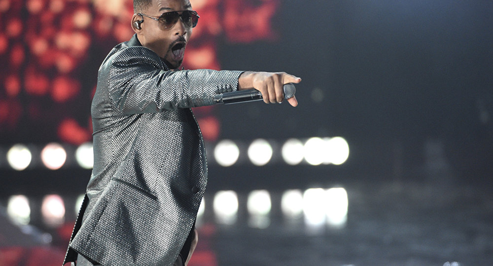 Will Smith gestures to the crowd as he performs Esta Rico at the Latin Grammy Awards on Thursday, Nov. 15, 2018, at the MGM Grand Garden Arena in Las Vegas.