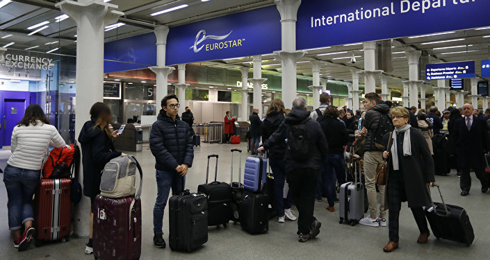 Travelers queue at St Pancras International train station in London, as Eurotunnel trains were suspended on Tuesday, Oct. 18, 2016.
