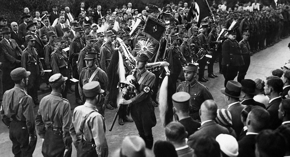 "National Socialist students of the Berlin University have solemnly received the old bell instrument of the former Fusilier regiment ""Queen Victoria of Sweden"" in Berlin, Aug. 30, 1933"