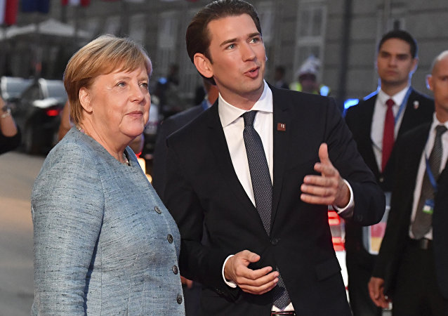 German Chancellor Angela Merkel talks to Austrian Chancellor Sebastian Kurz, right, when arriving at the informal EU summit in Salzburg, Austria, Wednesday, Sept. 19, 2018.