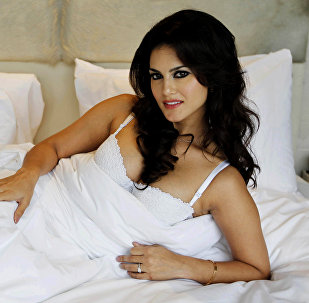 """In this Wednesday, Aug. 1, 2012 photo, hard-core porn actress Sunny Leone, who stars in Bollywood film """"Jism 2"""" poses during an event to promote the film in New Delhi, India"""