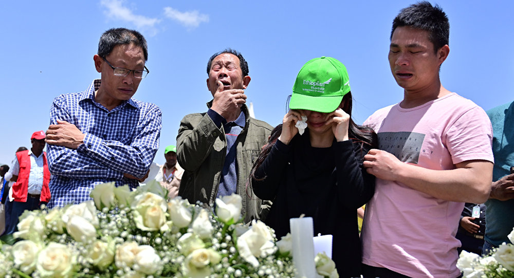 Family members mourn the victims at the crash site of the Ethiopian Airlines operated Boeing 737 MAX aircraft, at Hama Quntushele village in the Oromia region, on March 13, 2019