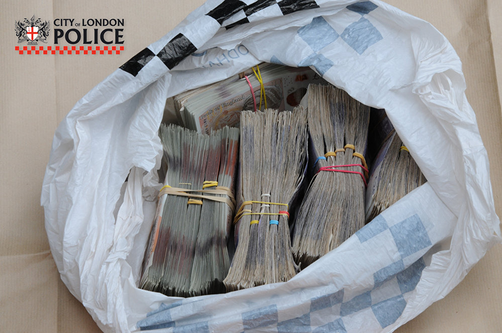 Almost £1 million in cash was discovered when City of London Police raided addresses in the capital in June 2018