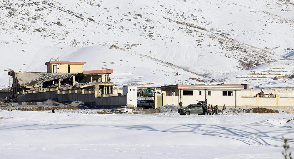 In this Monday, Jan. 21, 2019, photo, Afghan security forces inspect the site of a Taliban attack in Maidan Shar, capital of Maidan Wardak province, east of Kabul, Afghanistan. Afghan official said Tuesday, Jan. 22, 2019, scores of people mostly military personals were killed in the Taliban assault on a military base and a pro-government militia training center a day earlier in the province.