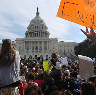 High school students demonstrate outside the U.S. Capitol building over gun violence and school shootings in Washington