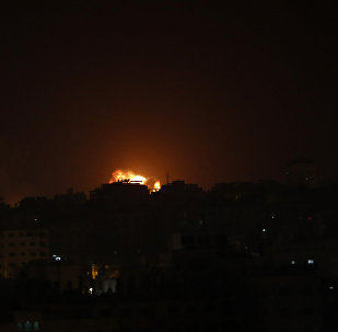 An explosion caused by Israeli airstrikes is seen on Gaza City, early Friday, March 15, 2019.