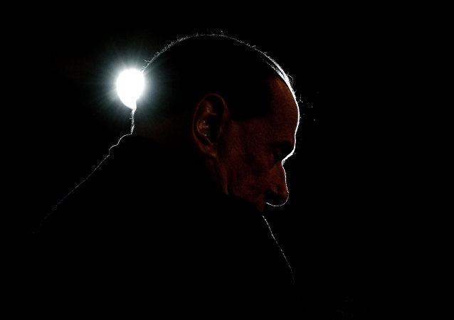 Leader of the Italian right-wing party Forza Italia (Go Italy) Silvio Berlusconi looks on during a campaign rally in Milan on February 25, 2018