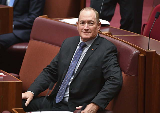 Australian senator Fraser Anning sits in the chamber during a session at Parliament House in Canberra, Wednesday, Aug. 15, 2018.