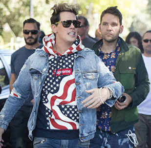 Conservative commentator Milo Yiannopoulos is escorted to the University of California, Berkeley campus where he is expected to speak to dozens of supporters on September 24, 2017