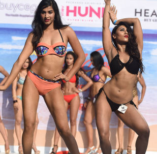 Indian fitness models perform on stage during the 'Body Power Beach Show'