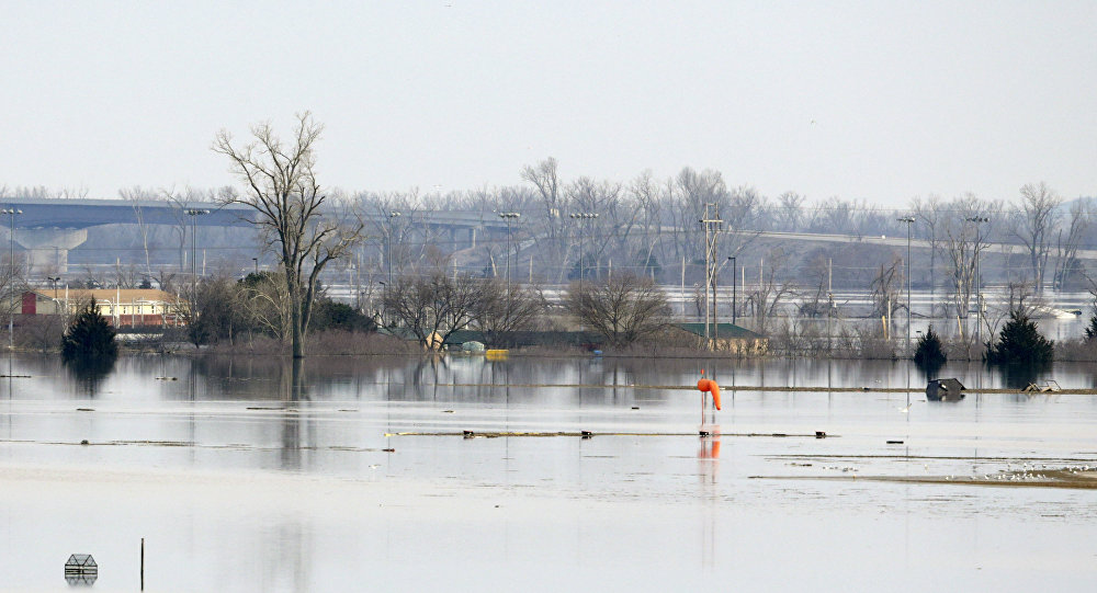 An orange windsock is seen at Offutt Air Force Base in Bellevue, Neb., site of the bases' flooded runway, Sunday, March 17, 2019.