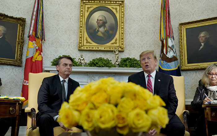 U.S. President Donald Trump speaks while meeting with Brazilian President Jair Bolsonaro in Oval Office of the White House in Washington, U.S., March 19, 2019.