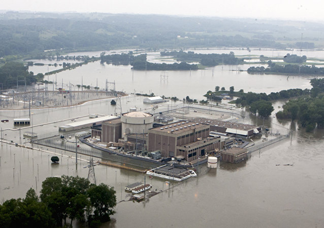 In this June 14, 2011 file photo, the Fort Calhoun nuclear power station, in Fort Calhoun, Neb., is surrounded by flood waters from the Missouri River