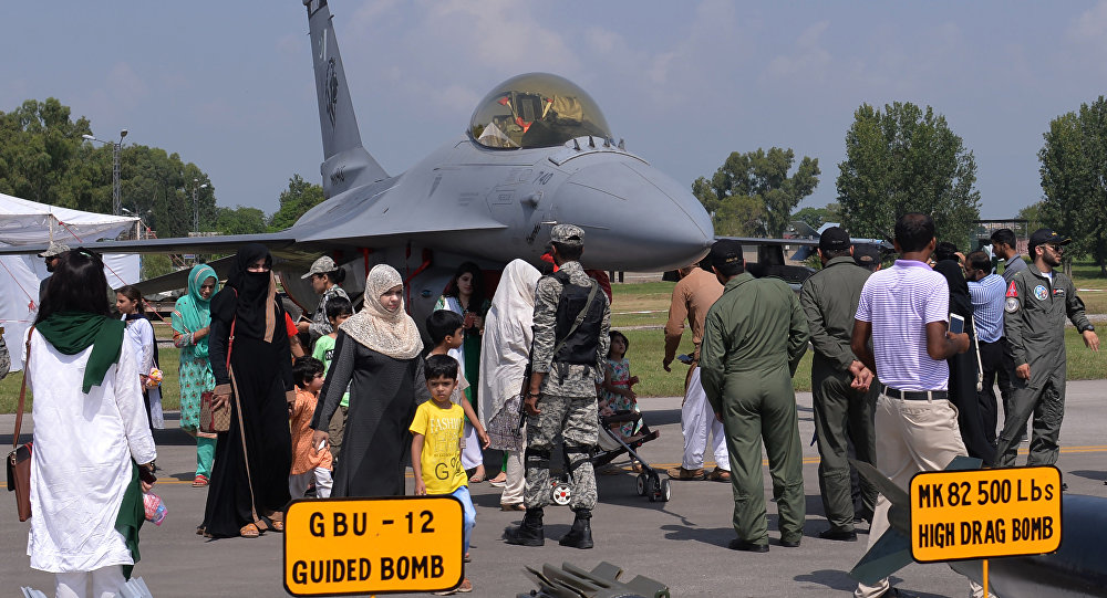 Pakistanis look at a F-16 jet fighter during celebrations to mark Defence Day at the Nur Khan military airbase in Islamabad (File)