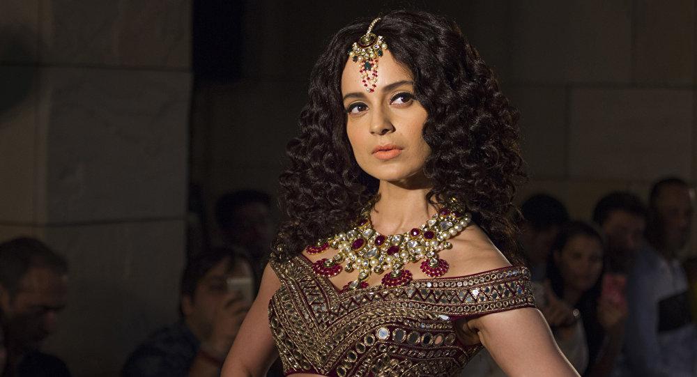 Bollywood actress Kangana Ranaut displays a creation by Indian designer Manav Gangwani at the India Couture Week 2016, in New Delhi, India, Sunday, July 24, 2016