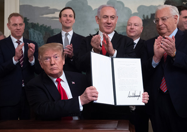 U.S. President Donald Trump holds a proclamation recognizing Israel's sovereignty over the Golan Heights as he is applauded by Israel's Prime Minister Benjamin Netanyahu and others during a ceremony in the Diplomatic Reception Room at the White House in Washington, U.S., March 25, 2019