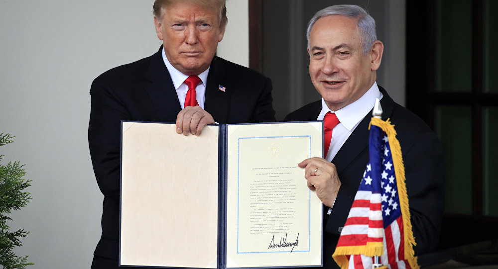 U.S. President Donald Trump and Israel's Prime Minister Benjamin Netanyahu hold up a proclamation recognizing Israel's sovereignty over the Golan Heights as Netanyahu exits the White House from the West Wing in Washington, U.S. March 25, 2019