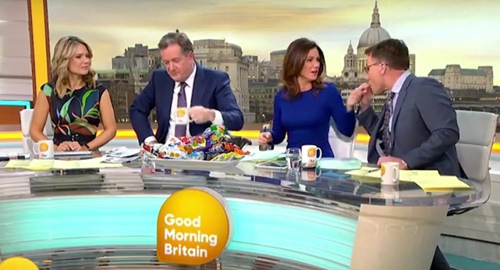 Moment Richard Arnold puts Susanna Reid's finger in his mouth