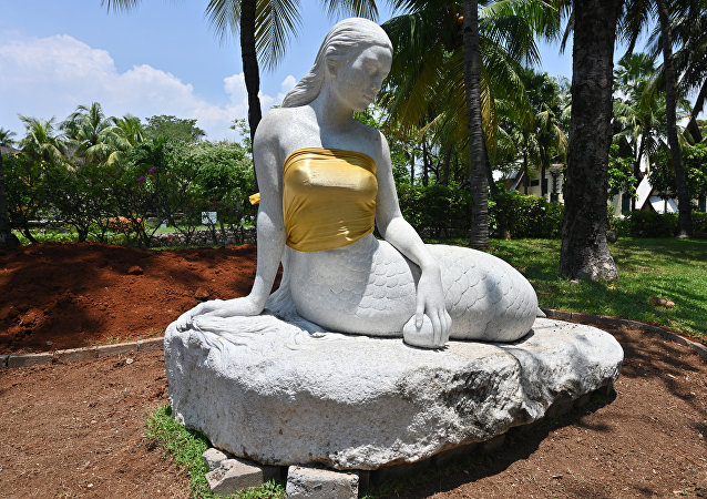 This picture taken at the Ancol amusement park in Jakarta on March 26, 2019 shows a statue of a mermaid with golden tube tops. A pair of bare-breasted mermaid statues have been given some family values treatment at an Indonesian theme park where officials slipped golden tube over their voluptuous assets.