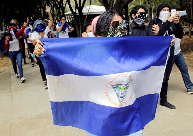 Masked demonstrators take part in a protest against Nicaraguan President Daniel Ortega's government