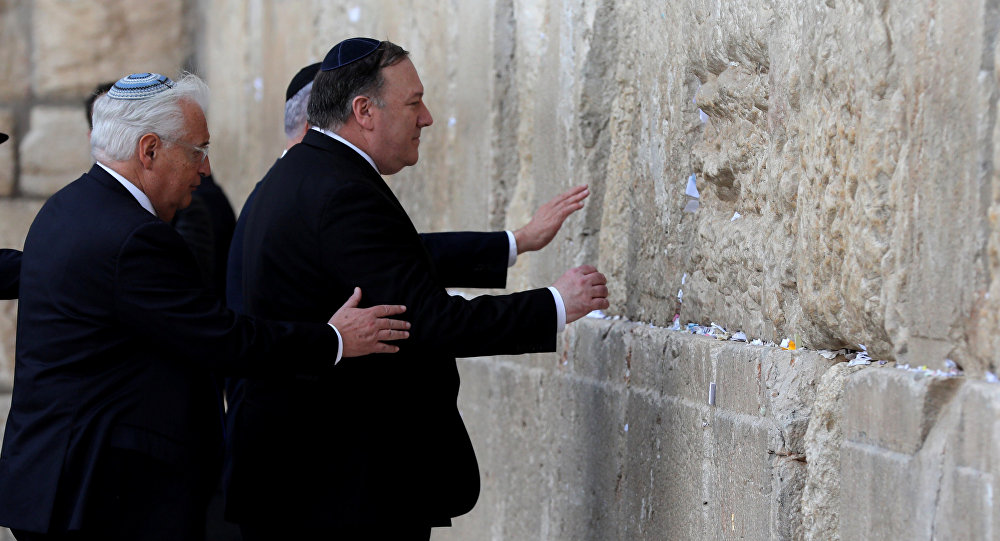 U.S. Secretary of State Mike Pompeo and U.S. Ambassador to Israel David Friedman touch the stones of the Western Wall during a visit to the site in Jerusalem's Old City March 21, 2019