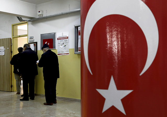 Voters wait in the line for cast their ballots at a polling station during the local elections in Ankara, Turkey, Sunday, March 31, 2019