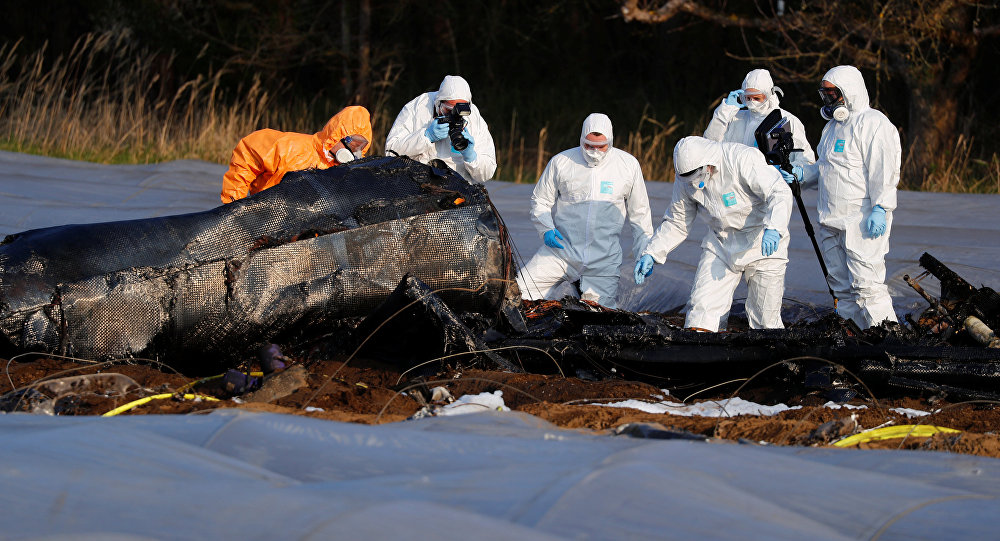 Police and forensic experts work next to the remains of a small plane that crashed near Erzhausen, Germany April 1, 2019