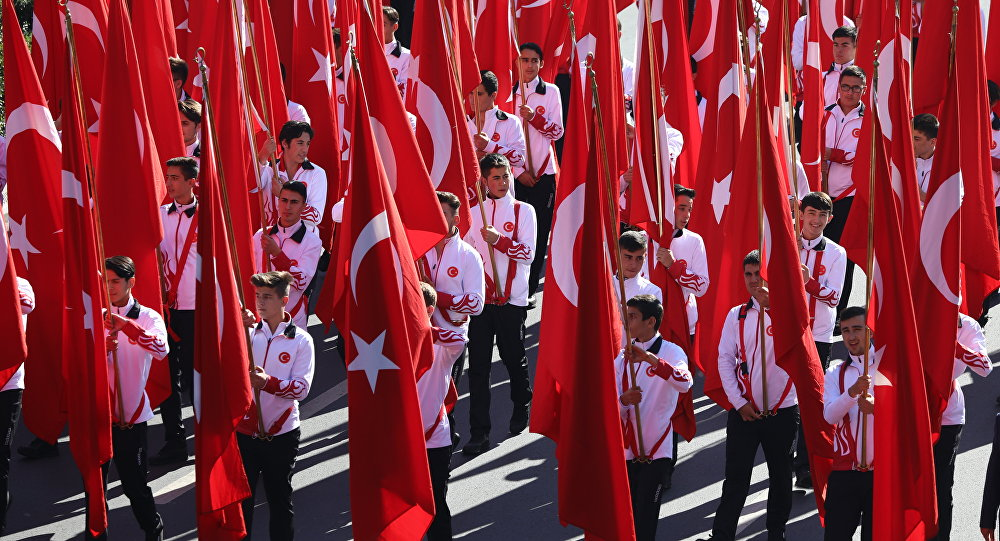 Students hold Turkish flags prior to a ceremony at the mausoleum of Turkey's founder Mustafa Kemal Ataturk on Republic Day in Ankara, Turkey, Monday, Oct. 29, 2018