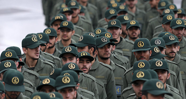 Iranian Revolutionary Guard members arrive for a ceremony celebrating the 40th anniversary of the Islamic Revolution, at the Azadi, or Freedom, Square, in Tehran, Iran, Monday, Feb. 11, 2019.