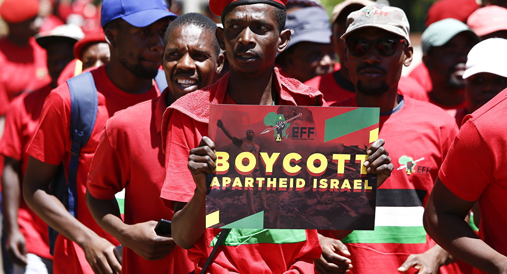 A man holds a sign as South African opposition Party Economic Freedom Fighters (EFF) members demonstrate to express their solidarity with the Palestinians in front of the Embassy of Israel in Pretoria, on November 2, 2017