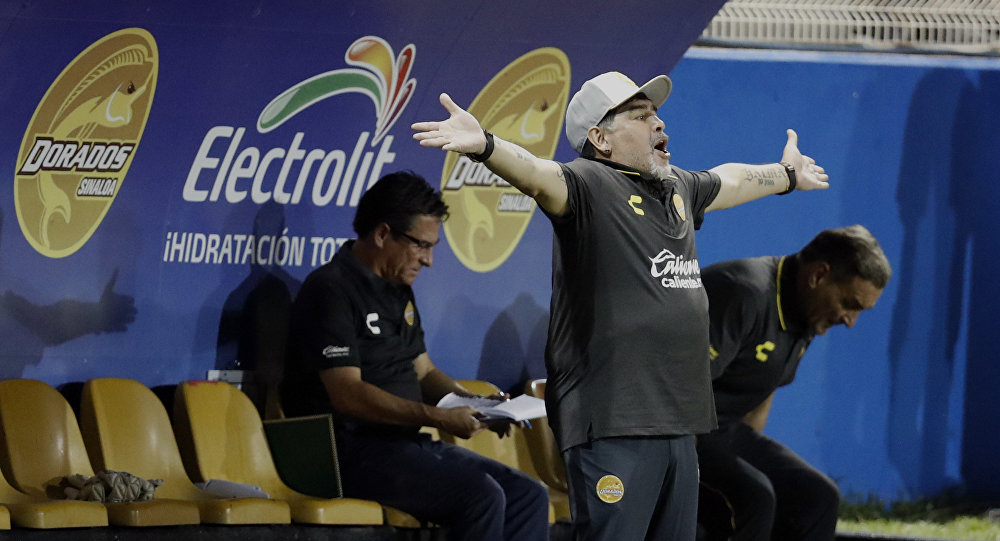 Diego Maradona, head coach of Dorados de Sinaloa soccer team, shouts from the sidelines of a second-tier national league soccer match against Cafetaleros, his first game as coach for Dorados in Culiacan, Mexico, Monday, Sept. 17, 2018