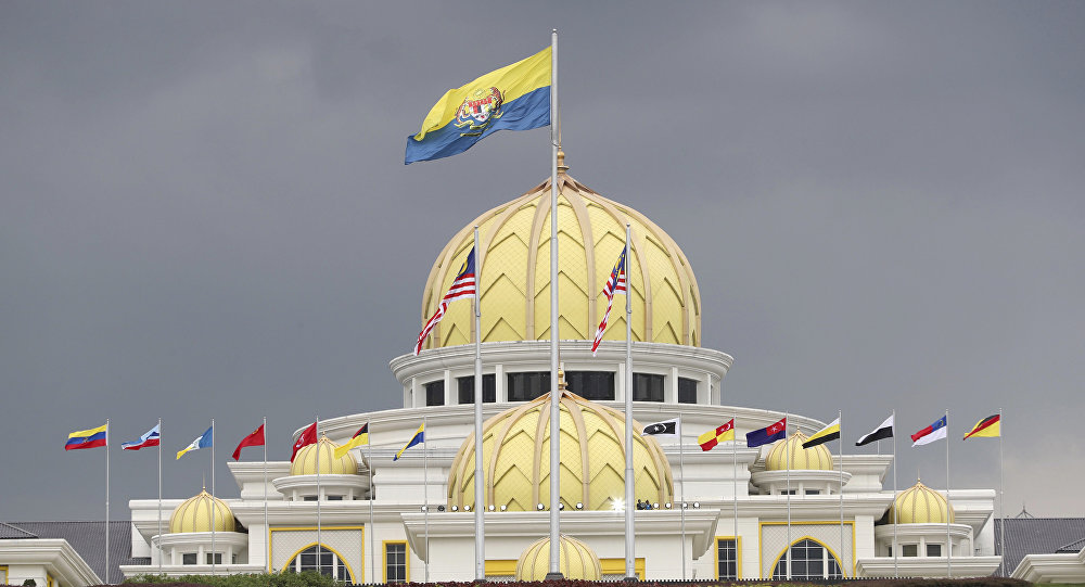 Flags fly at the Malaysia National Palace in Kuala Lumpur, Malaysia, Thursday, Jan. 24, 2019.