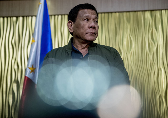 Philippines President Rodrigo Duterte arrives to greet Secretary of State Mike Pompeo at Colonel Jesus Villamor Airbase in Manila, Philippines, Thursday, Feb. 28, 2019
