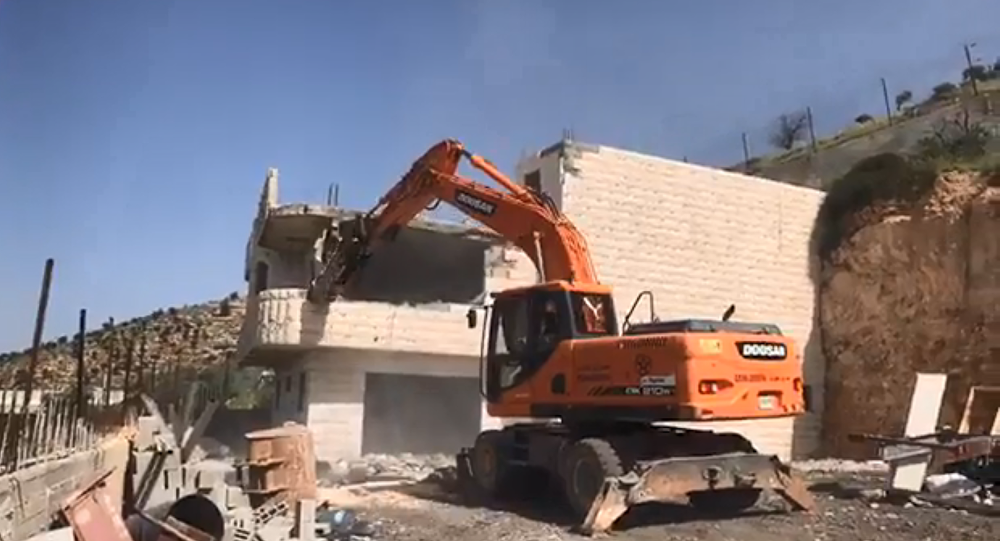 The Palestinian Zreina family is forced by the IDF to demolish their own family home in Bin Ouna, West Bank