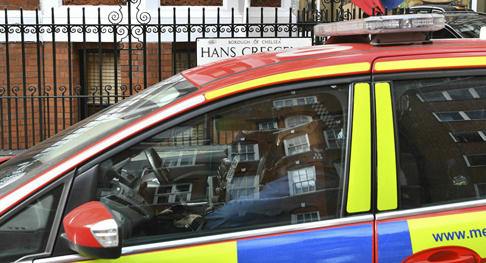 A police car parked outside the Ecuadorian Embassy in London, after WikiLeaks founder Julian Assange was arrested by officers from the Metropolitan Police and taken into custody Thursday April 11, 2019