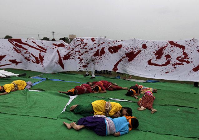 Artists reenact a scene from the 1919 Jallianwala Bagh massacre during a Special Olympics held by the survivors of the deadly 1984 Bhopal gas leak in an effort to shame Olympic sponsor Dow Chemical Co. on the eve of the London Games in Bhopal, India, Thursday, July 26, 2012