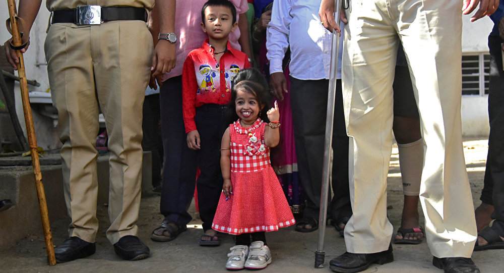 Jyoti Amge, 25, who holds the Guinness World Records title for the Shortest Living Woman, shows her ink-marked finger after casting her vote at a polling station during the first phase of the general election in Nagpur, India, April 11, 2019